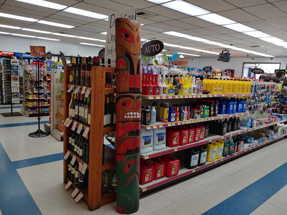 store aisle native sculpture