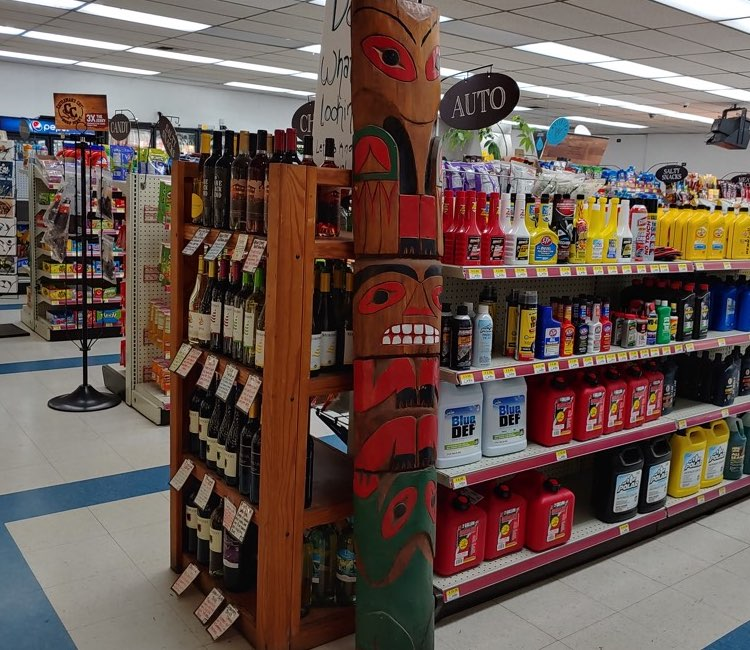 Kountry Korner store aisle with native sculpture - store photos